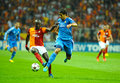 Sami khedira of madrid r real dribbling past galatasaray s dany nounkeu l their champions league group b soccer match at turk Stock Photography