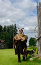 Sami shaman and his assistant dog finnish lapland Royalty Free Stock Photography