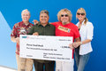 Sammy s gives back roseville ca september lr rich peterson dave martinez hagar kari hagar hagar and wife kari make a donation to Stock Photos