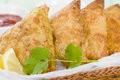 Samosas deep fried stuffed pasties served with lemon wedges chili sauce and yoghurt raita Royalty Free Stock Photos