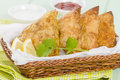 Samosas deep fried stuffed pasties served with lemon wedges chili sauce and yoghurt raita Royalty Free Stock Photo