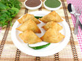Samosas and green and tamarind chutneys Royalty Free Stock Photo