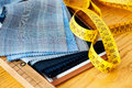 Sample fabric swatches on a tailors workbench Royalty Free Stock Photo