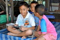 Samut Songkhram, Thailand: Boys with PSP Stock Photos