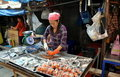 Samut Songkhram, Thailand: Fish Seller at Market Stock Image