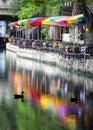San antonio riverwalk festive colored umbrellas and patriotic decorations on the riverfront Stock Photo