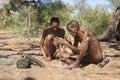 San Bushmen starting a fire Royalty Free Stock Photo