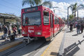 San diego trolley ysidro usa november passengers board the blue line at the southernmost station stop at the us mexico border Royalty Free Stock Photos