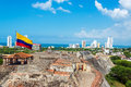 San felipe castle and skyline view of de barajas the of cartagena colombia with a large colombia flag Stock Photography