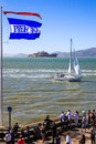 San francisco alcatraz sailing pier summer crowds check out the view of a sailboat passing by world famous prision island from the Royalty Free Stock Photo