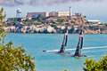 San francisco america s cup team oracle passing alcatraz two multi million dollar sailboats practice in front of famous island in Royalty Free Stock Images