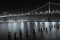 The san francisco bay bridge at night in black and white Royalty Free Stock Image