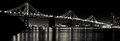 San francisco bay bridge at night black and white a evening shot of the glowing in from treasure island in Stock Photos
