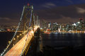 San Francisco Bay Bridge and skyline at night Royalty Free Stock Photo