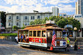 San francisco cable car hyde beach turnaround passengers on a bright sunny morning wait at the friedel klussmann memorial at and Royalty Free Stock Photography