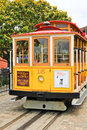 San francisco cable car yellow painted bright at the friedel klussmann memorial turnaround located at hyde and beach streets Stock Photo