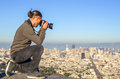 San francisco citscape from twin peaks man photographing cityscape Royalty Free Stock Photo