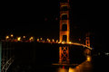 San Francisco - Golden Gate Bridge Lit at Night Royalty Free Stock Photo