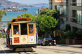 San francisco hyde street cable car passengers riding one of the iconic famous powell cars climbing up with historic alcatraz Stock Photography