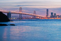 The san francisco oakland bay bridge brilliant twilight waters set off and residential towers in Royalty Free Stock Images