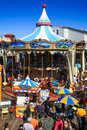 San francisco pier colorful carousel summer crowds especially families with children check out the historic near the end of Stock Photo