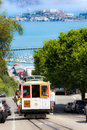 San francisco powell hyde cable car alcatraz passengers riding one of the iconic famous cars climbing up street with historic Royalty Free Stock Photo