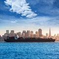 San francisco skyline with merchant ship cruising bay at califor california usa Stock Photo