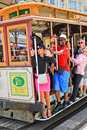 San francisco waving cable car passengers happy wave while riding one of the iconic famous powell hyde cars on washington street Royalty Free Stock Photography