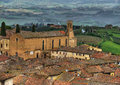 San gimignano italy looking over the rooftops of the church of agustin and the countryside in Stock Images