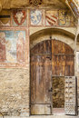 San gimignano tuscany siena italy wooden door of medieval palace with frescos Stock Image