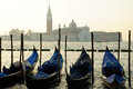 San giorgio maggiore island venice sunset gondolas foreground Royalty Free Stock Images