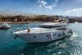 SAN JUAN, TENERIFE/SPAIN - FEBRUARY 25 : Motor cruiser leaving S Royalty Free Stock Photo