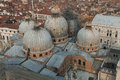 San marco basilica domes and roofs of venetian houses top view Stock Images