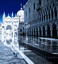 San marco piazza with stars and reflections in the flood water showing the doge s palace and st mark s basilica Stock Images