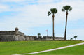 San marcos castle in florida historic stone of at st augustine with grassy field and palm trees Stock Images