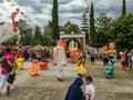 Mojigangas and children dancing at Calenda San Pedro in Oaxaca, Mexico.
