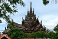 Sanctuary of truth pattaya is a temple construction in thailand it is an all wood building filled with sculptures based on Royalty Free Stock Photo