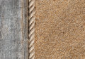 Sand background with old wood and rope Royalty Free Stock Photo