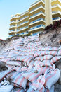 Sand bags against beach erosion miami qld australia Royalty Free Stock Photos