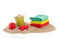 Towels and toys at the beach Royalty Free Stock Photo