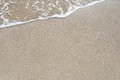 Sand beach water wave background Royalty Free Stock Photo