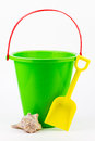 A sand bucket, shovel, and seashell. Royalty Free Stock Images