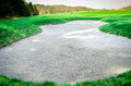 Sand bunker on the golf course sand trap Royalty Free Stock Photo