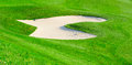 Sand bunker on the golf field Royalty Free Stock Photography