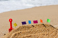 Sand castle at beach with colorful flags the Royalty Free Stock Photos
