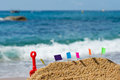Sand castle at beach with colorful flags the Stock Photography
