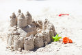 Sand castle and beach toys on tropical white beach Stock Photography