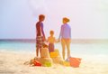 Sand castle on tropical beach, family vacation Royalty Free Stock Photo