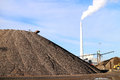 Sand, coal and power plant Stock Photos