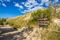 Sand dune tourist trail sign wooden gate to Wydma Lacka -  Slowi Royalty Free Stock Photo